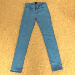 Aqua colored skinny jeans.